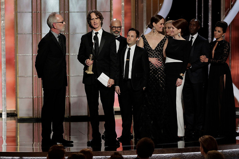 ". Winner Jay Roach (C), for Best Miniseries or Motion Picture Made for Television award for ""Game Change\"" on stage with other members of the production at the 70th annual Golden Globe Awards in Beverly Hills, California January 13, 2013, in this picture provided by NBC. REUTERS/Paul Drinkwater/NBC/Handout"