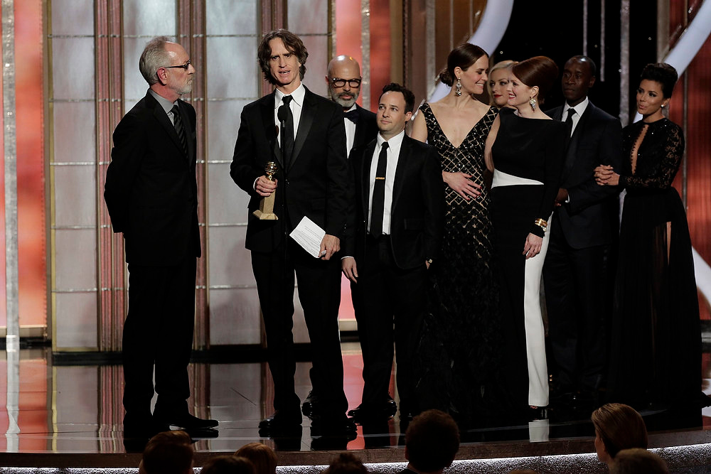 Description of . Winner Jay Roach (C), for Best Miniseries or Motion Picture Made for Television award for