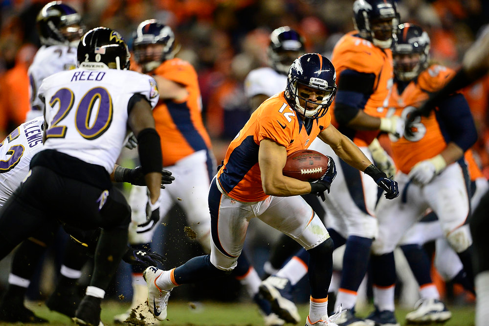 Description of . Denver Broncos wide receiver Matt Willis (12) runs for a 7-yard gain in the fourth quarter. The Denver Broncos vs Baltimore Ravens AFC Divisional playoff game at Sports Authority Field Saturday January 12, 2013. (Photo by AAron  Ontiveroz,/The Denver Post)