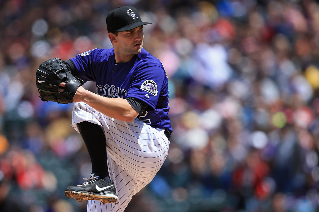 . Starting pitcher Tyler Chatwood #32 of the Colorado Rockies delivers against the Atlanta Braves at Coors Field on April 24, 2013 in Denver, Colorado.  (Photo by Doug Pensinger/Getty Images)