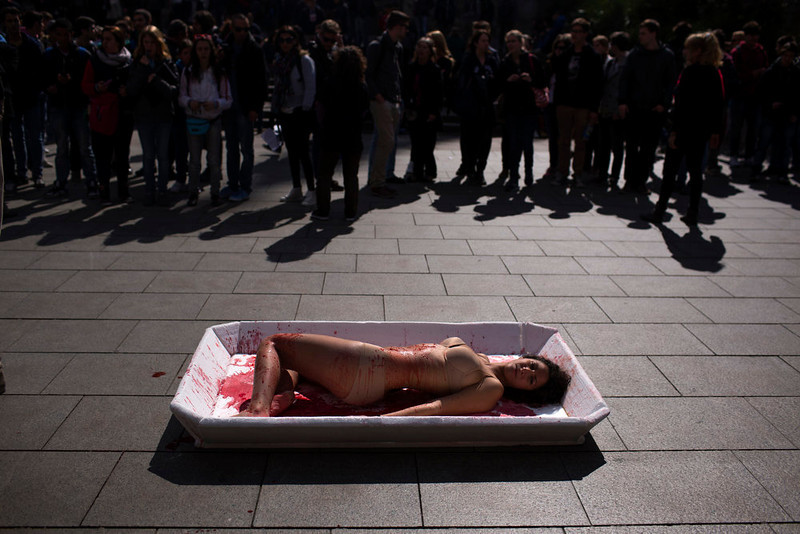 ". An animal rights activist from the group \'Animal Equality\' lies in a tray representing meat packaging during a protest to celebrate the ""Day Without Meat\"" event in Barcelona, Spain, Wednesday, March 20, 2013. (AP Photo/Emilio Morenatti)"