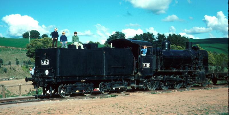 1976-8 (11) Andrew 7 yrs, Allen 5 yrs 3 mths, David 12 yrs 8 mths & Susan 11 yrs on train @ Kurumburra.jpg