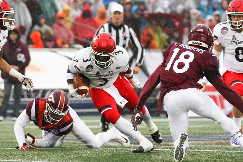 Cincinnati running back #3 Michael Warren II cuts to evade Virginia Tech free safety #18 Tyree Rodgers