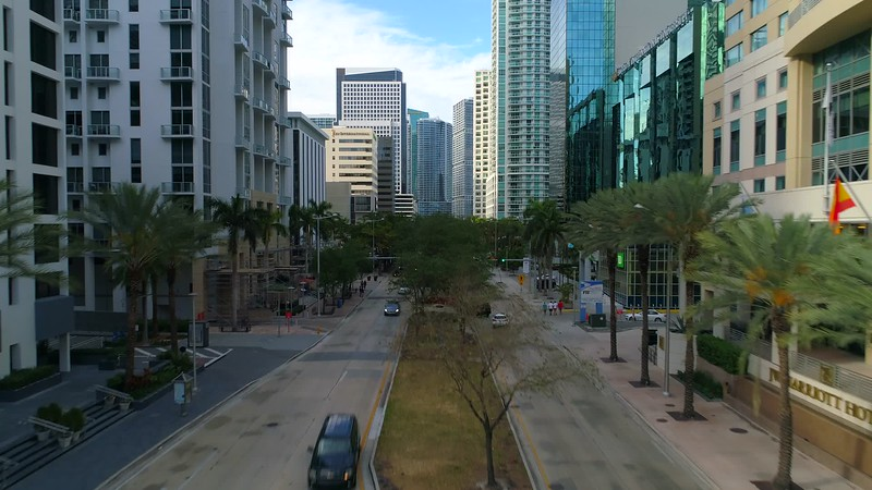 Aerial drone flying between buildings Miami Brickell Avenue