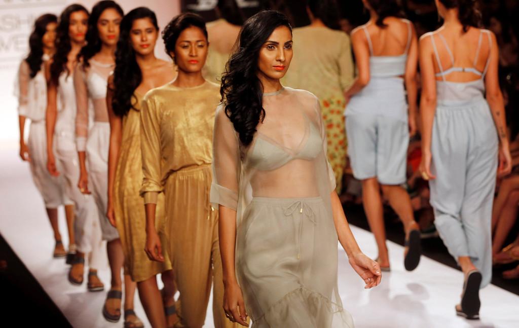 . Models walk the ramp to showcase creations by Nishka Lulla during the Lakme Fashion Week in Mumbai, India, Wednesday,  March 12, 2013. (AP Photo/Rajanish Kakade)