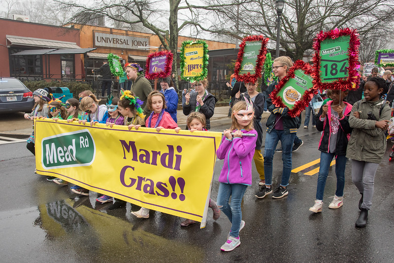 A whole bunch of excited children are happy to carry the lead off banner for the parade Saturday in Decatur
