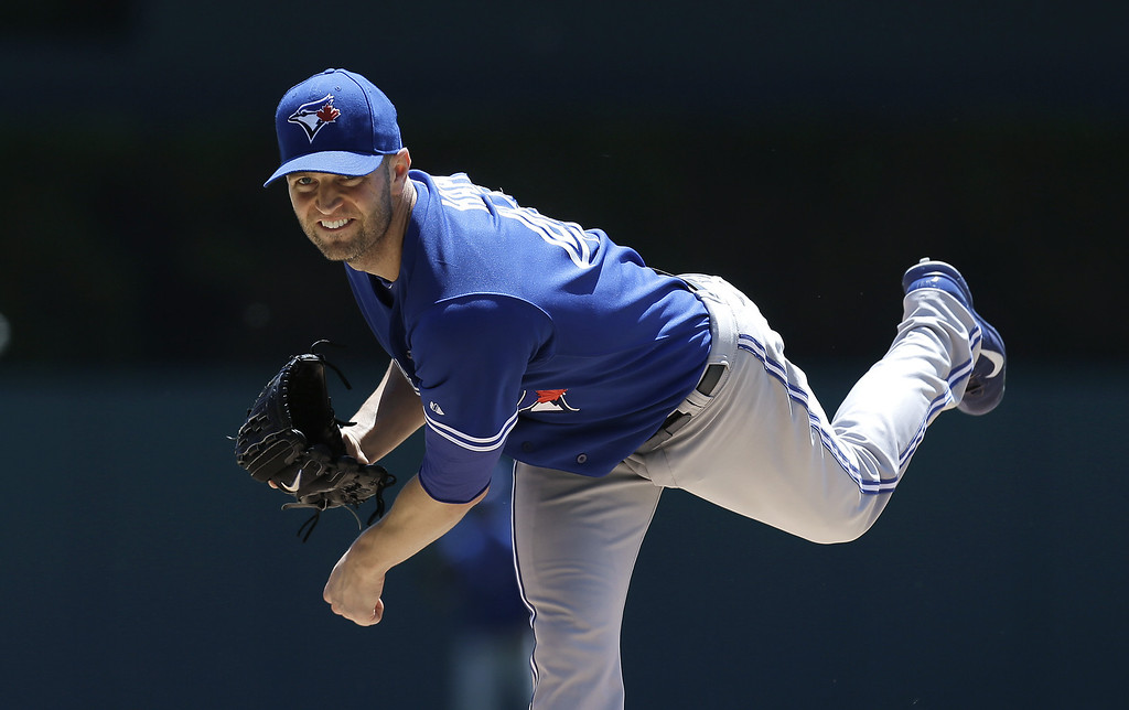 . Toronto Blue Jays pitcher J.A. Happ throws a warmup pitch against the Detroit Tigers in the first inning of a baseball game in Detroit, Thursday, June 5, 2014. (AP Photo/Paul Sancya)