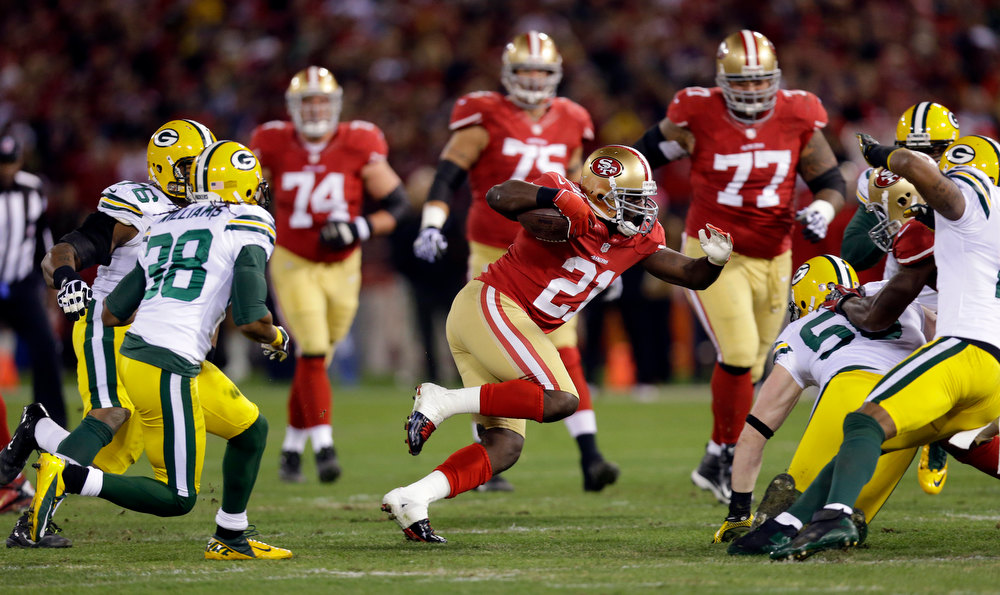 Description of . San Francisco 49ers running back Frank Gore (21) carries the ball in the first quarter of an NFC divisional playoff NFL football game against the Green Bay packers in San Francisco, Saturday, Jan. 12, 2013. (AP Photo/Marcio Jose Sanchez)