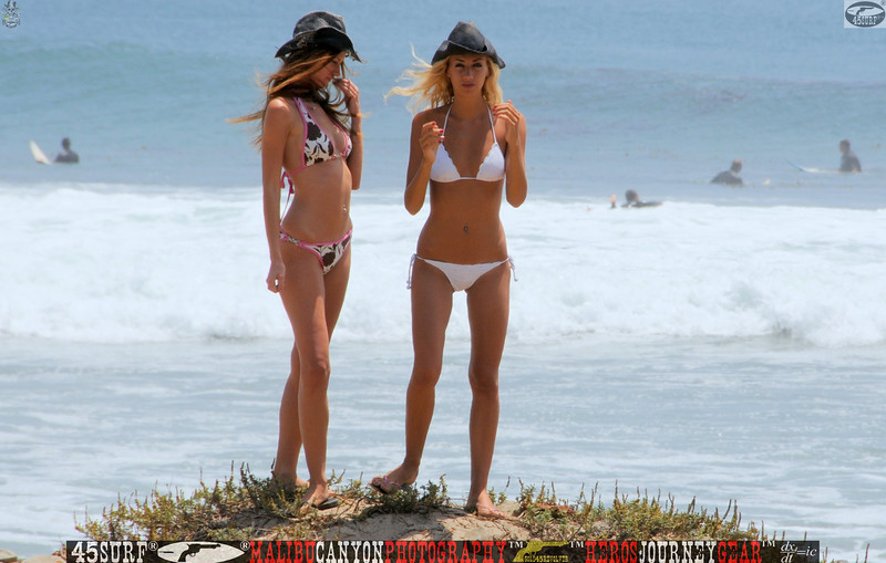 Two Swimsuit Bikini Models in Front of Surfers