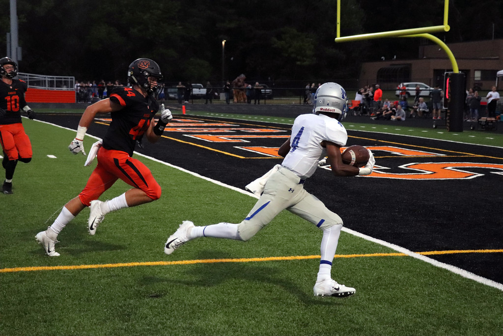 . Nicholas Pfeifer - The Morning Journal<br> Midview\'s Isiah Johnson reels in the deep ball from Andrew Gooch for a Middie touchdown against North Olmsted on Sept. 7.