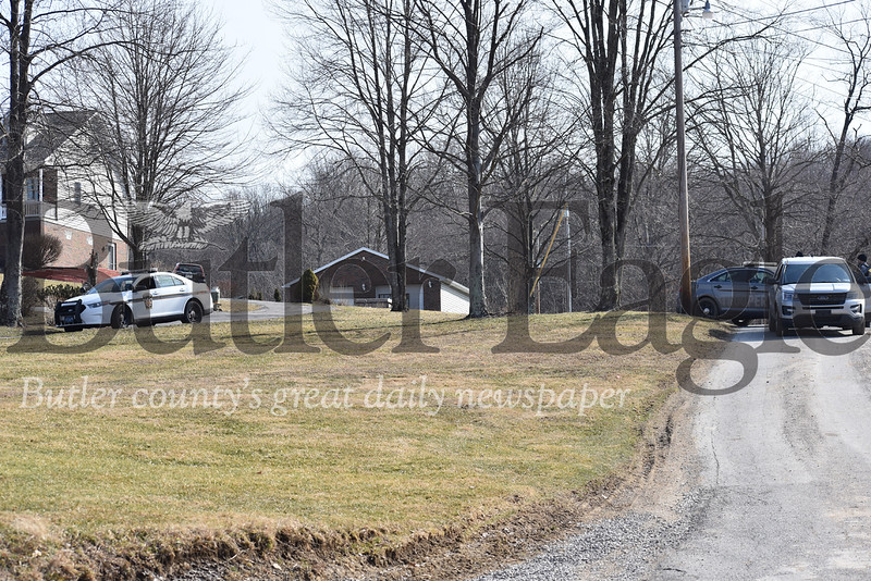 eavily armed troopers with State Police Wednesday lockdown the area around Davis Road where a a 23-year-old man was killed in what police say was a homicide.photos by Eric Jankiewicz