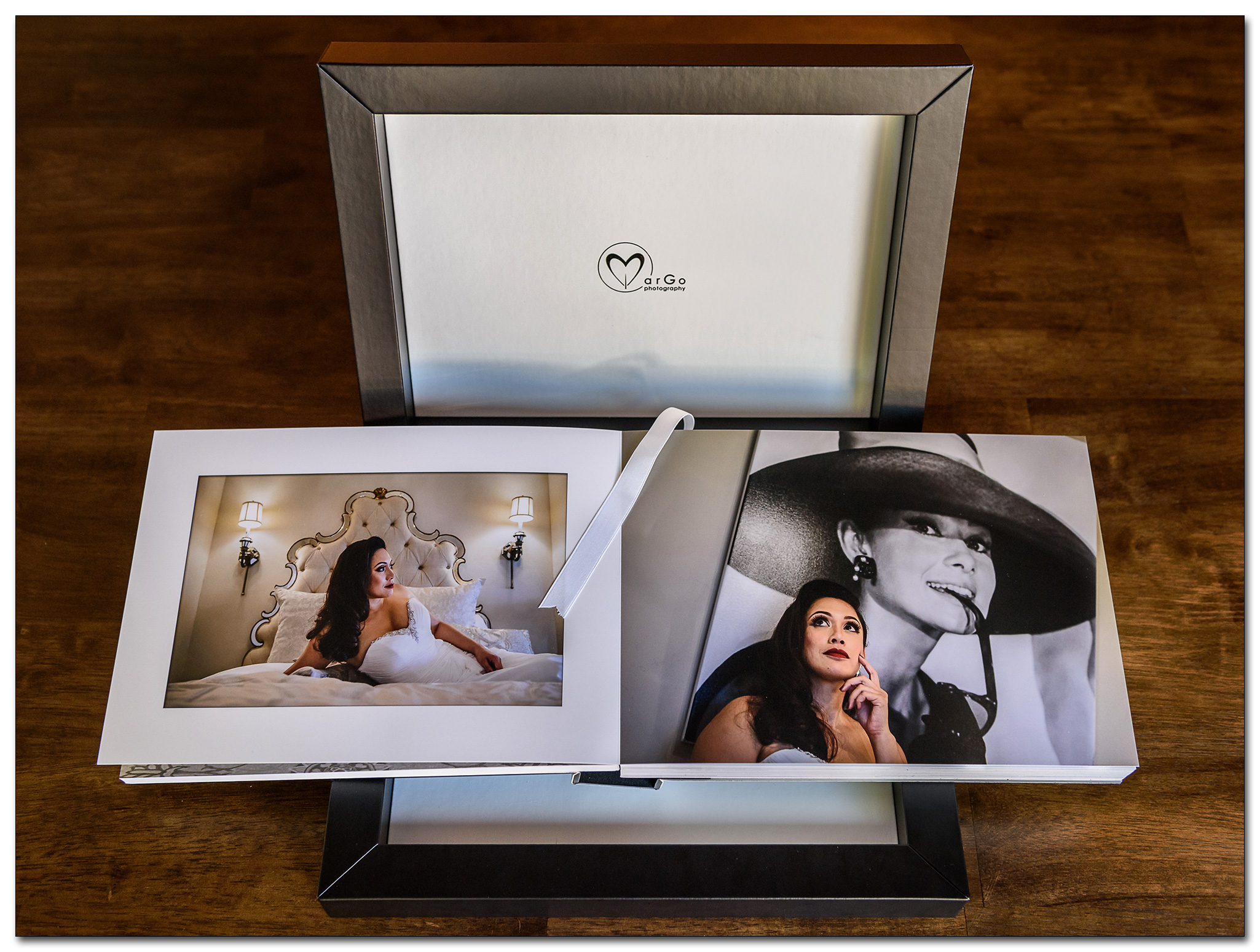 opened Italian wedding album laying on the black cloud leatherette box