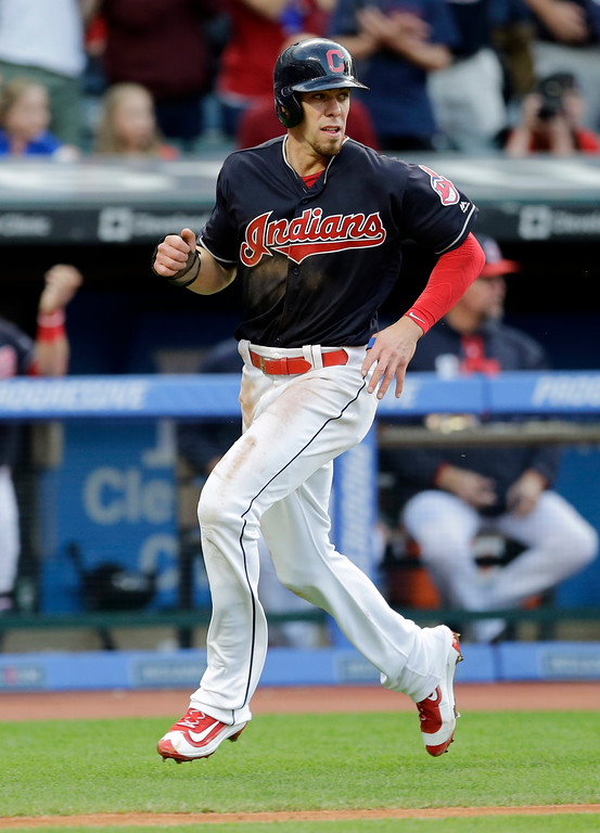 . Cleveland Indians\' Bradley Zimmer runs home on an RBI-single by Cleveland Indians\' Francisco Lindor in the third inning of a baseball game, Friday, May 26, 2017, in Cleveland. (AP Photo/Tony Dejak)