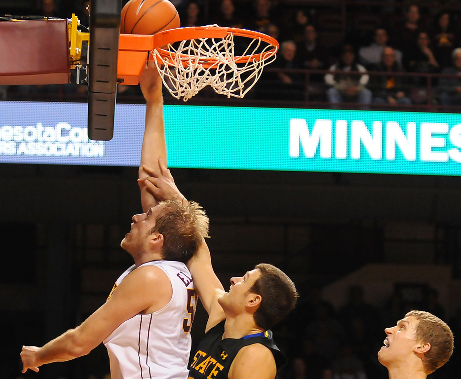 . Minnesota center Elliott Eliason lays in two against South Dakota State forward Cody Larson in the second half. (Pioneer Press: John Autey)
