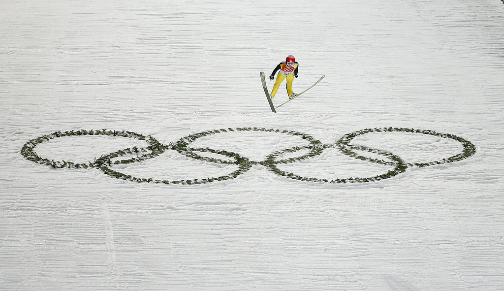 . Simon Ammann of Switzerland competes in the Men\'s Large Hill Individual Qualification Round in RusSki Gorki Jumping Center at the Sochi 2014 Olympic Games, Krasnaya Polyana, Russia, 14 February 2014.  EPA/VALDRIN XHEMAJ