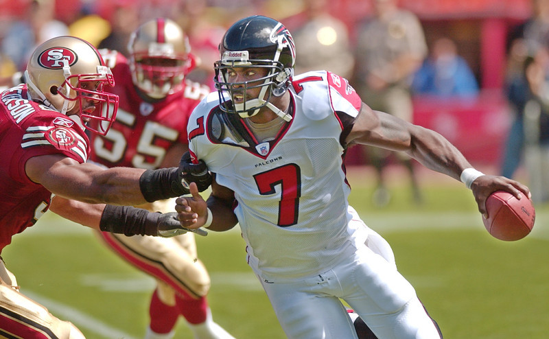 . Michael Vick, Virginia Tech Selected first overall by the Falcons in 2001 Vick went from the most electrifying man in football to one of the most hated men in football when he was jailed following the 2006 season for his involvement in a dog-fighting ring. He returned in 2009 as a backup for Philadelphia, and earned the starting role in 2010. He has struggled to stay healthy in four years with the team, though, and his Eagles missed the playoffs each of the last two seasons. GRADE: B. Had he avoided a detour to prison in his prime, he could have been a Hall of Famer. (AP Photo/Paul Sakuma)