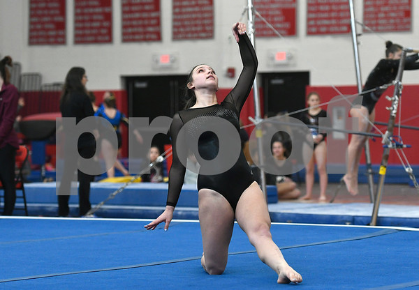 1/6/2018 Mike Orazzi | Staff Bristol Central's Karissa Ouellette while competing during the floor exercise at the Pomperaug Open held at Pomperaug High School Saturday.
