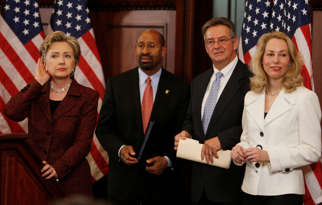 . Democratic presidential hopeful, Sen. Hillary Rodham Clinton, D-N.Y., left, takes questions as she stands with, from left to right: Philadelphia Mayor Michael Nutter, former ambassador Joseph Wilson and his wife, former CIA officer Valerie Plame, in Philadelphia, Tuesday, March 18, 2008. (AP Photo/Charles Dharapak)
