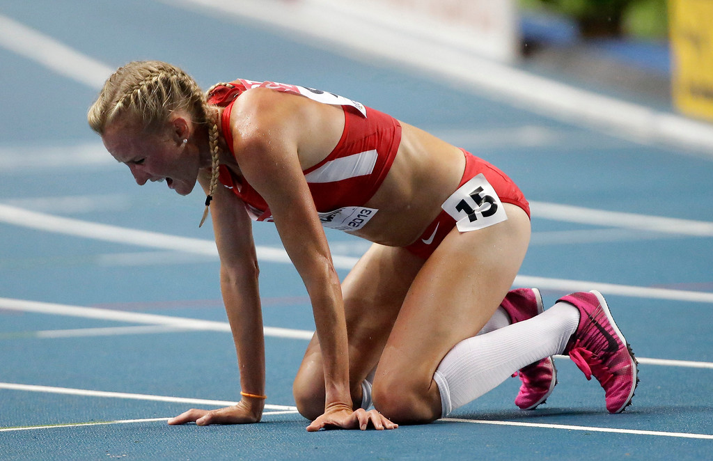 . United States\' Shalane Flanagan reacts after competing in the women\'s 10000-meter final at the World Athletics Championships in the Luzhniki stadium in Moscow, Russia, Sunday, Aug. 11, 2013. (AP Photo/Anja Niedringhaus)