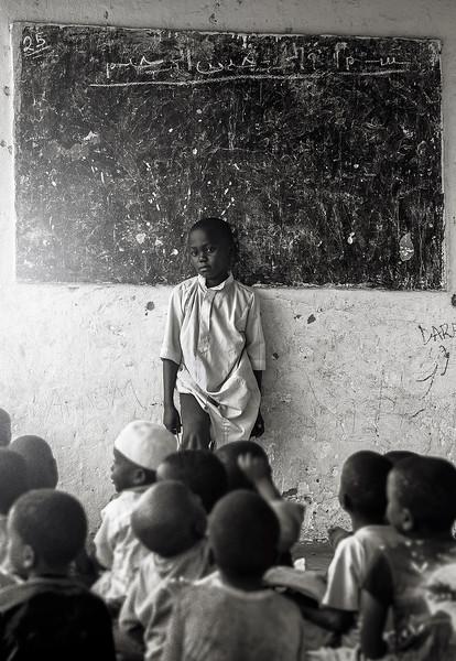 A young man takes control of the Koranic school in a small fishing village south of Pangani.  Tanzania, 2019.