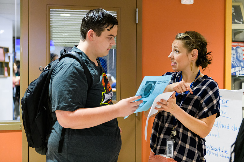 School testing coordinator Aubrie VanBuskirk helps a student adjust his schedule. Back to school day at McNary High School on Wednesday, September 4, 2019 in Keizer, Ore.
