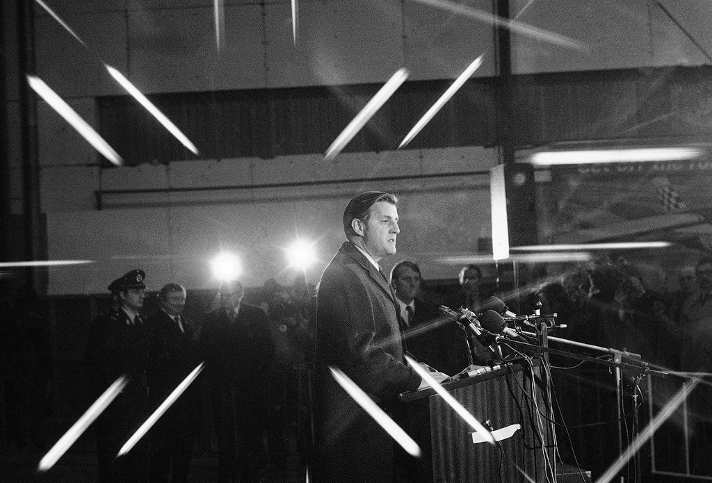 . U.S. Vice President Walter Mondale in the limelights of U.S. and international press and radio television as he reads a brief statement in an airport hangar after arriving at Brussels Airport at the beginning of his European tour, Jan. 23, 1977. (AP Photo/Bob Daugherty)