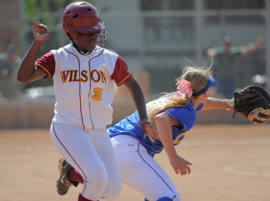 . 05-16-2013-( Daily Breeze Staff Photo by Sean Hiller) Wilson vs. El Toro in the opening round of the CIF-SS D2 playoffs Thursday at Joe Rodgers Field in Long Beach. Wilson\'s Unique Whitehurst is safe at first against El Toro\'s Kristen Weiser.