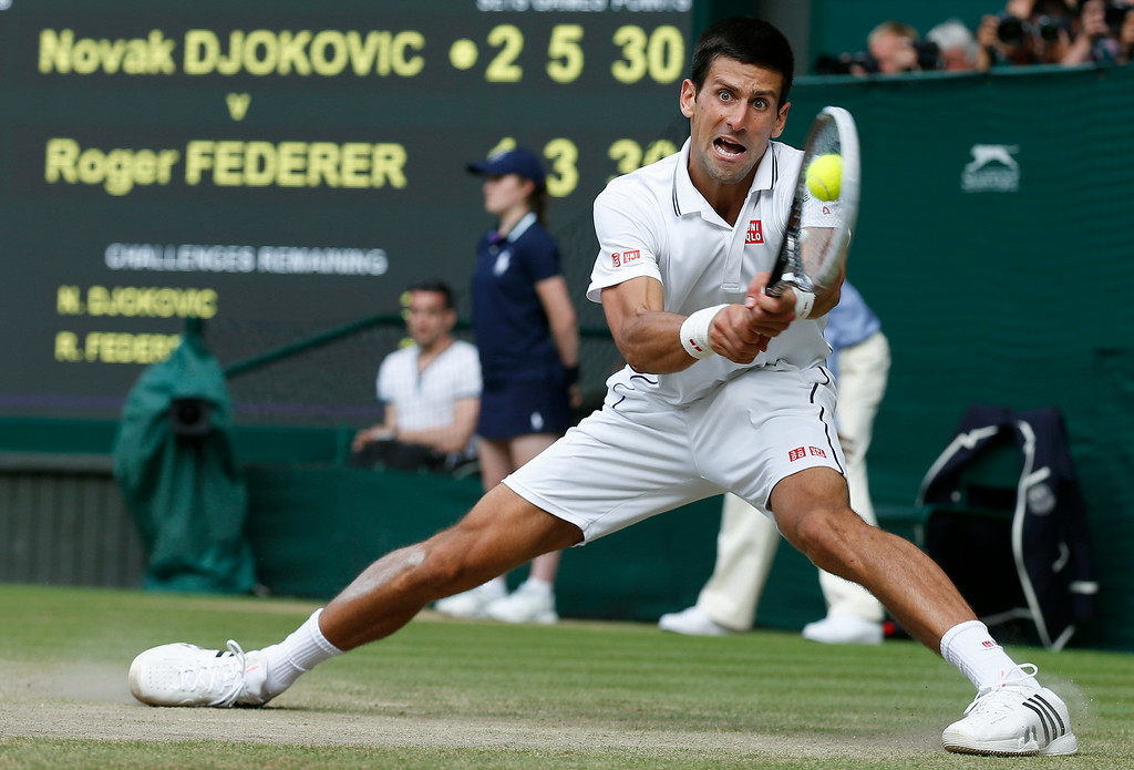 . Novak Djokovic of Serbia watches the ball hit his racquet as he plays a return to Roger Federer of Switzerland during their men\'s singles final match at the All England Lawn Tennis Championships in Wimbledon, London, Sunday, July 6, 2014. (AP Photo/Sang Tan, Pool)