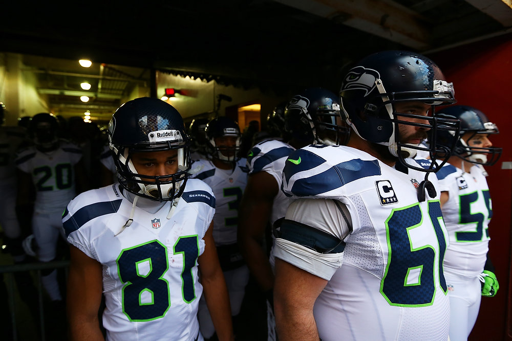 . Max Unger #60, Golden Tate #81 and the Seattle Seahawks prepare to take the field for their NFC Wild Card Playoff Game against the Washington Redskins at FedExField on January 6, 2013 in Landover, Maryland.  (Photo by Al Bello/Getty Images)