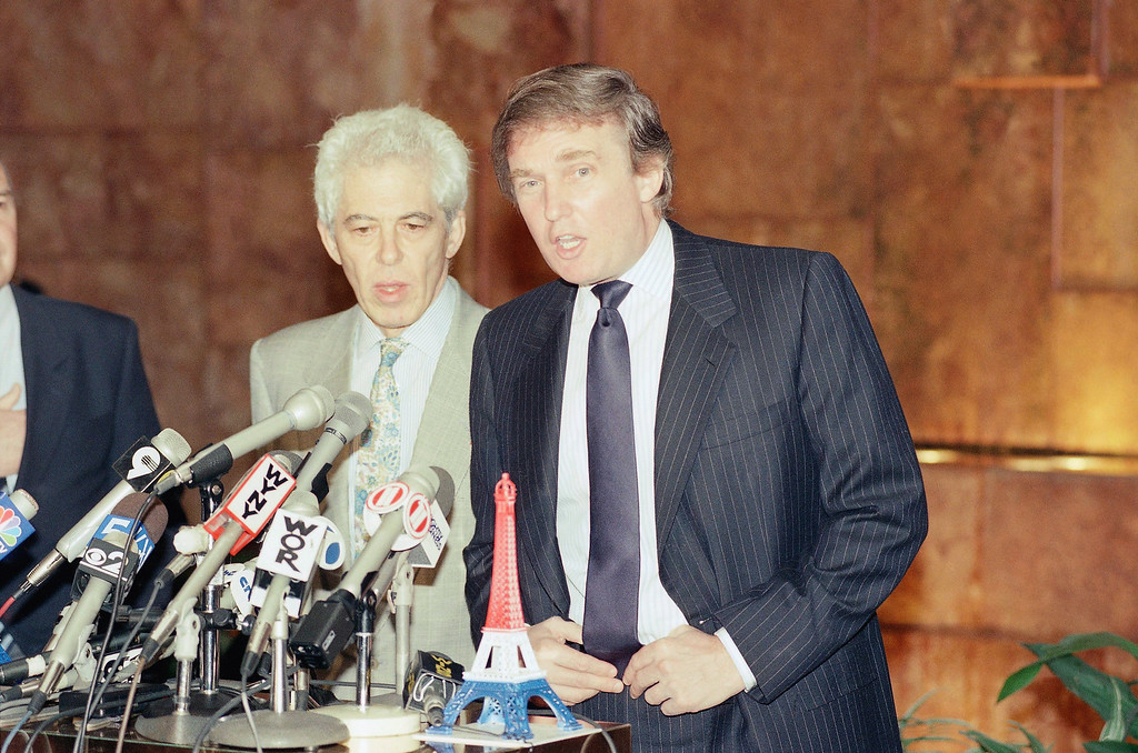 . Donald Trump, right, speaks to the media in New York, as George Meyer, chairman of Galeries Lafayette, listens, July 9, 1990 .  (AP Photo/Richard Drew)