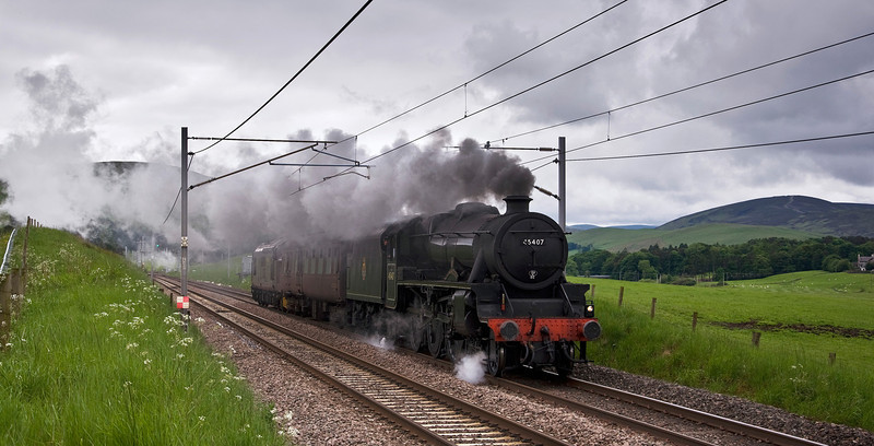 """Eventually 45407 """"The Lancashire Fusilier"""" is given the all clear from the loop at Abington and provides a wonderful sight and sound as it accelerates away."""