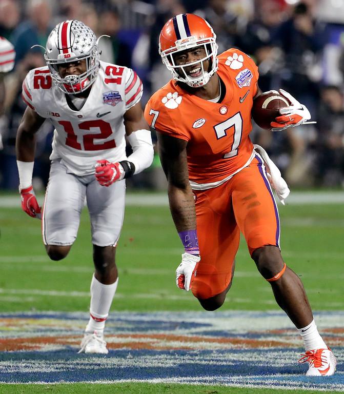 . Clemson wide receiver Mike Williams (7) runs as Ohio State cornerback Denzel Ward (12) pursues during the first half of the Fiesta Bowl NCAA college football playoff semifinal, Saturday, Dec. 31, 2016, in Glendale, Ariz. (AP Photo/Rick Scuteri)