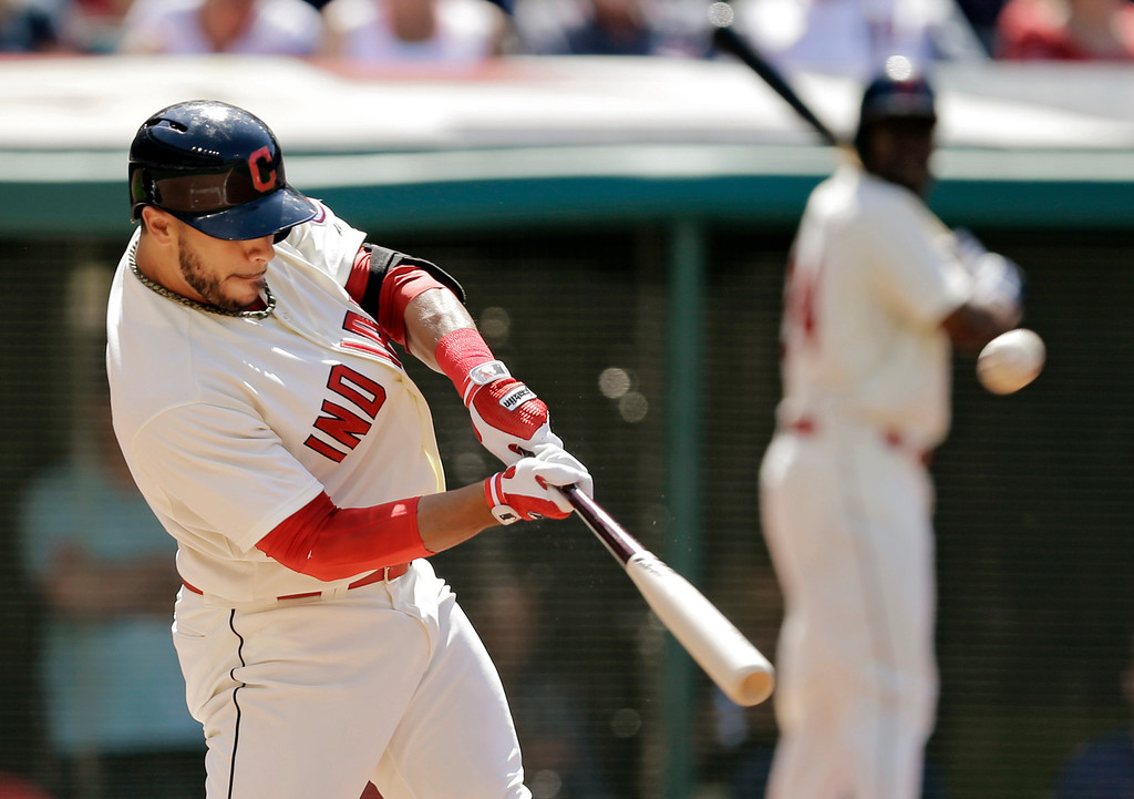 . Cleveland Indians\' Mike Aviles hits a three-run home run off Colorado Rockies starting pitcher Franklin Morales in the second inning of a baseball game Saturday, May 31, 2014, in Cleveland. (AP Photo/Mark Duncan)