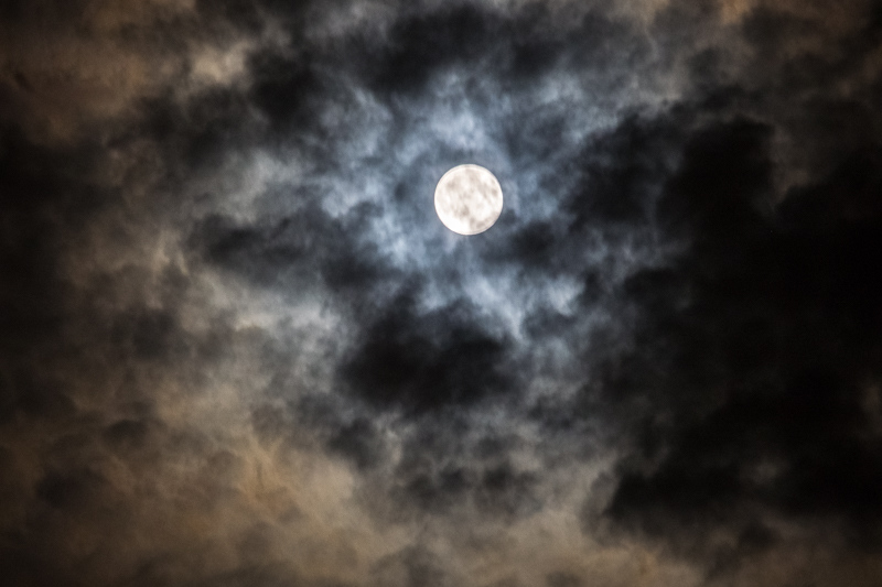 July  8 - Moon on a wierr is now a moon subdued by clouds.jpg
