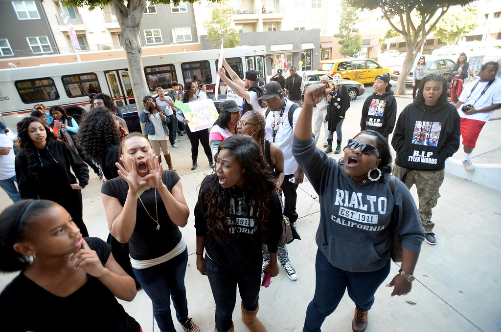 . Community members, friends and family of Tyler Woods, who was shot by the Long Beach Police Department on Nov. 19, protested his shooting death with a march to the police department headquarters in Long Beach on Sunday, November 24, 2013. (Photo by Sean Hiller/ Daily Breeze).