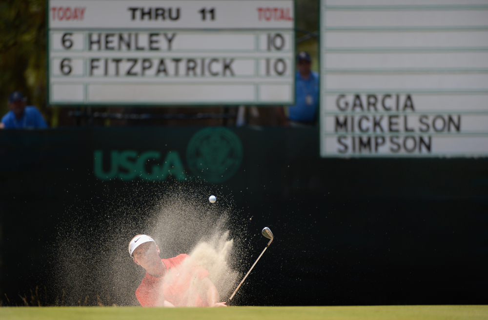 . Russell Henley of the United States hits his third shot from a bunker on the 12th hole during the third round of the 114th U.S. Open at Pinehurst Resort & Country Club, Course No. 2 on June 14, 2014 in Pinehurst, North Carolina.  (Photo by Ross Kinnaird/Getty Images)
