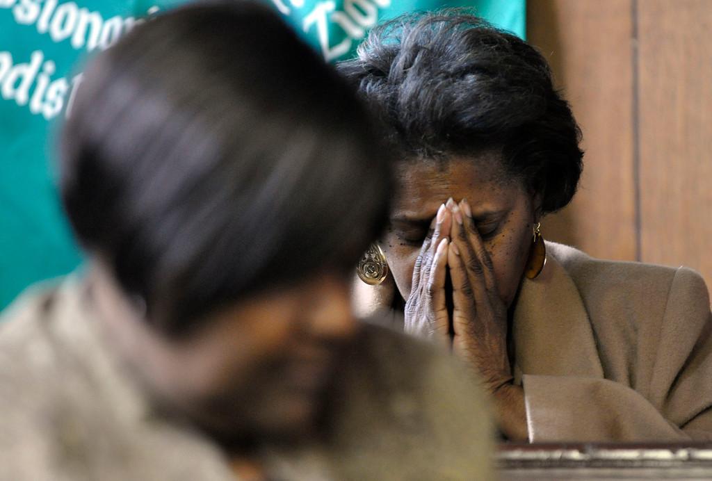 . Valerie Hamilton prays at a memorial service for David Glasser, Mon Nov 28, 2011 (GARVER)