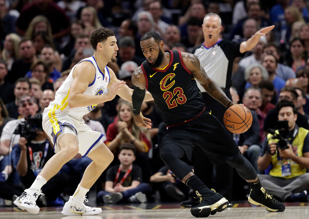 . Cleveland Cavaliers\' LeBron James is defended by Golden State Warriors\' Klay Thompson during the first half of Game 4 of basketball\'s NBA Finals, Friday, June 8, 2018, in Cleveland. (AP Photo/Tony Dejak)