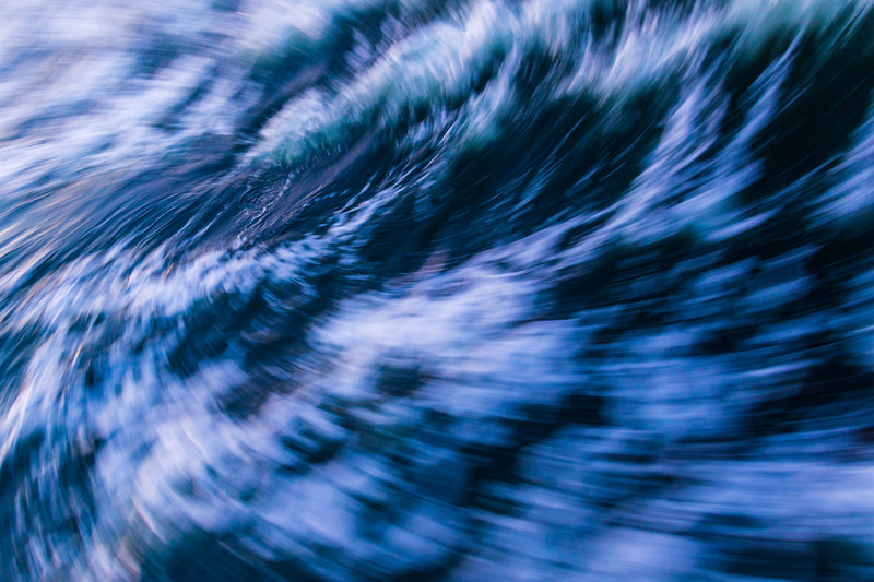 Ocean waves are blurred into a churning froth in this abstract image