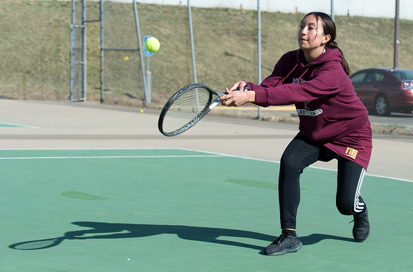 04/02/19 Wesley Bunnell | Staff New Britain girls tennis took on Wilcox Tech in their first matches of the season on Tuesday afternoon. Yajaira Asimbaya competes in doubles.
