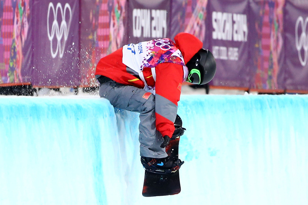 . Yiwei Zhang of China crashes as he competes in the Snowboard Men\'s Halfpipe Finals on day four of the Sochi 2014 Winter Olympics at Rosa Khutor Extreme Park on February 11, 2014 in Sochi, Russia.  (Photo by Al Bello/Getty Images)