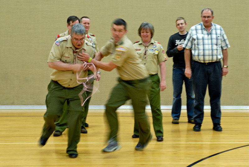 2011/4/21 – Another night of adult scout leader training. This is a knot relay race. The guy on the left, Ray, is a trainer on my team. The guy on his right is attending training, but is also Ray's son. He was trying to make sure his dad had no chance in the race. He ran into him and took his rope. Ray still won.
