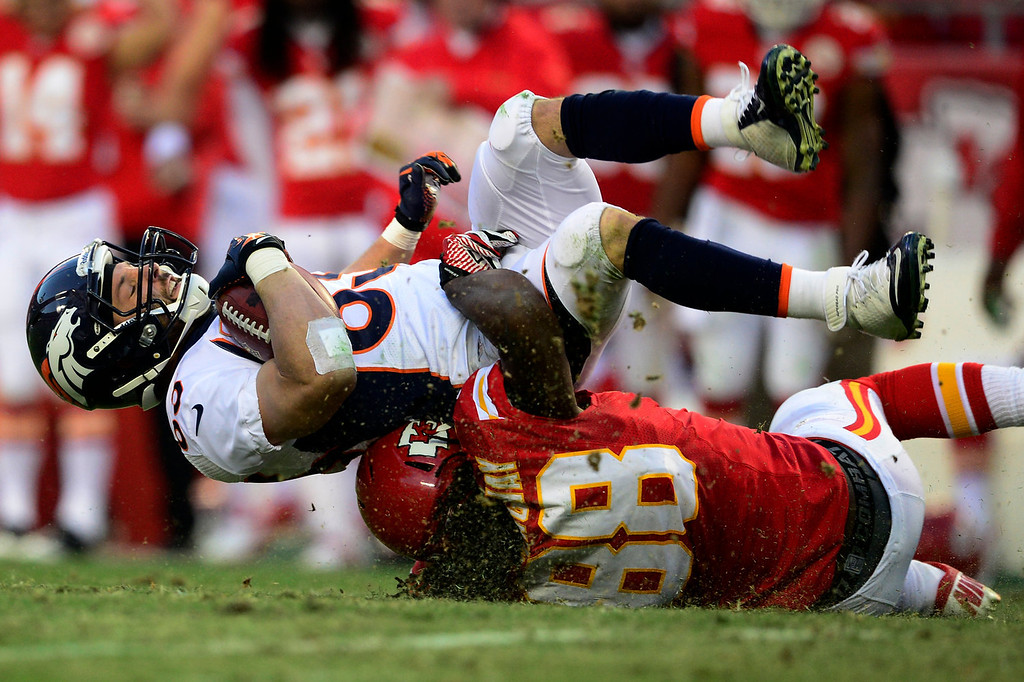 . Wes Welker (83) of the Denver Broncos gets tackled by Junior Hemingway (88) of the Kansas City Chiefs during the first half of action at Arrowhead Stadium. The Denver Broncos visit the Kansas City Chiefs in an AFC West showdown. (Photo by AAron Ontiveroz/The Denver Post)