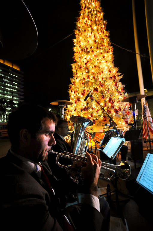 . Brass Pacifica performs during the annual lighting of the Los Angeles County Christmas Tree December 2 , 2013 in Los Angeles, CA.  The 50-foot tree is located in front of the  Los Angeles County Music Center in downtown Los Angeles.(Andy Holzman/Los Angeles Daily News)