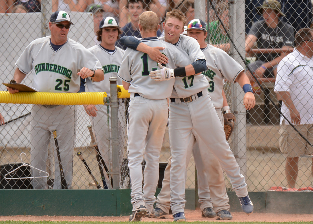 . DENVER, CO. - MAY 25: Brody Westmoreland (17) celebrate scoring of Mark Hopper (11) of ThunderRidge HIgh School in the 7th inning of 5A baseball state championship game against Rocky Mountain High School at All City Field. Denver, Colorado. May 25, 2013. ThunderRidge won 2-1. (Photo By Hyoung Chang/The Denver Post)