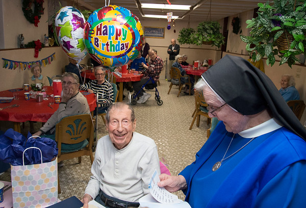 01/13/20 Wesley Bunnell | StaffrrAlexander Wojtera celebrated his 100th birthday at St. Lucian&quote;s Residence on Monday evening featuring proclamations received from the offices of Mayor Erin Stewart and Congresswoman Jahana Hayes and an upcoming honor from President Donald Trump which will arrive soon. Wojtera smiles as Sister Mary Clare Milewski reads off the names of the popes and presidents he has outlived.