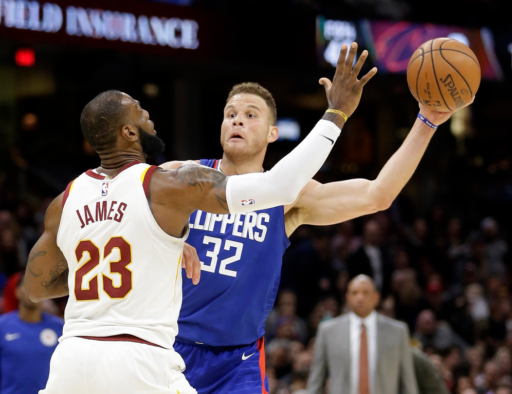 . Los Angeles Clippers\' Blake Griffin (32) looks to pass over Cleveland Cavaliers\' LeBron James (23) in the second half of an NBA basketball game, Friday, Nov. 17, 2017, in Cleveland. The Cavaliers won 118-113 in overtime. (AP Photo/Tony Dejak)