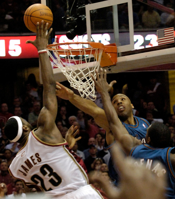 . M Blair LeBron James hits the game winning shot in OT over the top of the Wizards Michael Ruffin and Gilbert Arenas .
