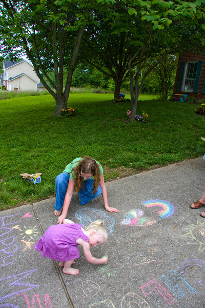 Abigail and Chloe drew with chalk on the driveway for mom.