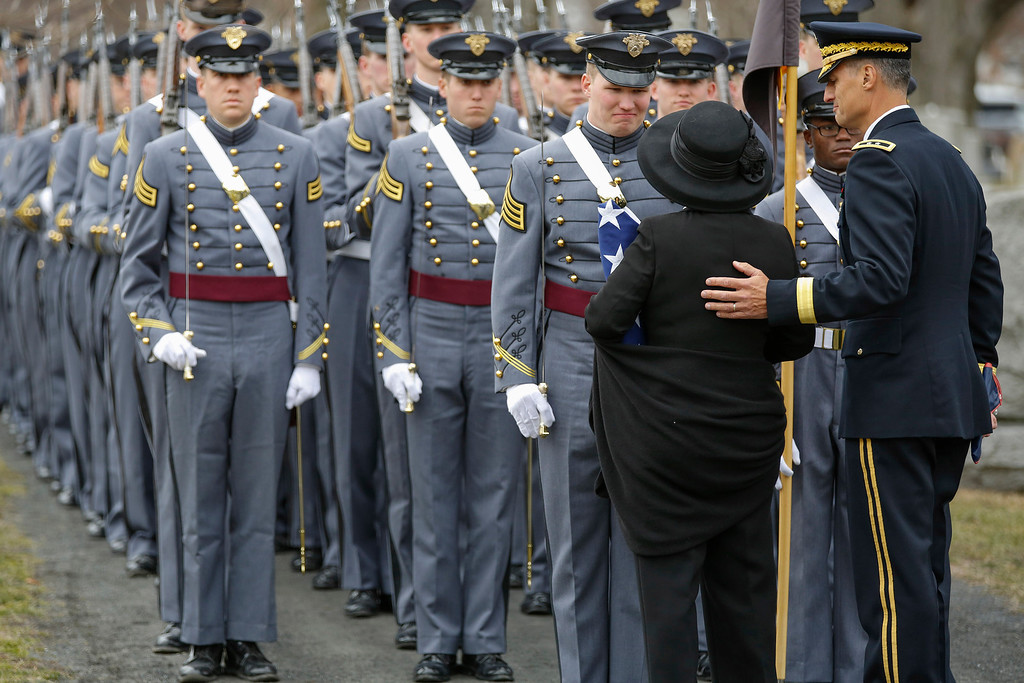 . Brenda Schwarzkopf, at left, back to camera, greets United States Military Academy cadets from Company A-1 after the burial of  Gen. Norman Schwarzkopf  at the United States Military Academy on Thursday, Feb. 28, 2013, in West Point, N.Y. Gen. Schwarzkopf was in the company when he was a cadet. Accompanying her at right is Major General Kenneth Tovo. Schwarzkopf was 78 when he died of complications from pneumonia on Dec. 27 in Tampa. (AP Photo/Philip Kamrass)